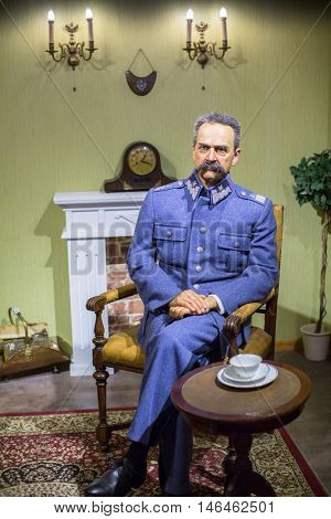 KRAKOW, POLAND - FEB 9, 2016: Jozef Pilsudski wax figures of Polonia Wax Museum at Main Market Square. The Wax Museum was opened in 2016, inspired by the organization in Krakow World Youth Day.