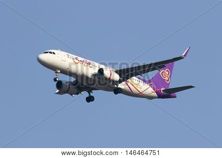 CHIANGMAI THAILAND - FEBRUARY 26 2014: HS-TXG Airbus A320-200 with winglet of Thaismile airway. Landing to Chiangmai airport from Bangkok Suvarnabhumi.