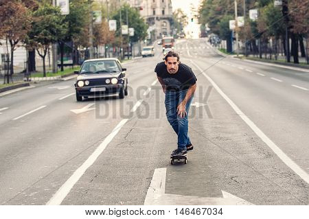 Skateboarder Riding A Skateboard Slope On The City Streets