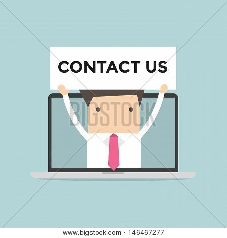 Businessman holding Contact us sign in computer notebook