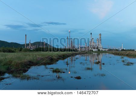 reflection of petrochemical industry power station in evening