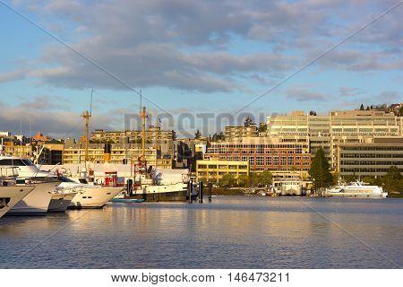 Sunrise over Lake Union in Seattle Washington USA. Lake Union panorama with boats and seaplane docks.