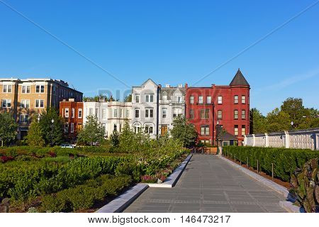 Residential architecture of North East surburb of Washington DC. Colorful row houses surronded by garden.