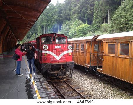 ALISHAN TAIWAN - MAY 4 2013 : Alishan forest train in Alishan National Scenic Area during spring season. People can seen exploring around it