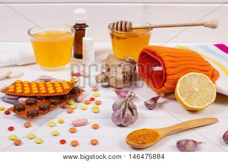 Medical Pills, Hot Water Bottle And Ingredients For Preparation Warming Beverage