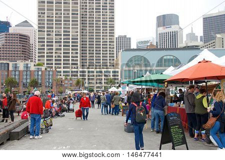 San Francisco CA - August 20 2016: Unidentified people at the Ferry Plaza Farmer's Market renowned throughout the country as one of the top farmers markets having nearly 25000 shoppers weekly.