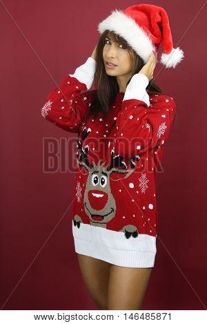Beautiful woman wearing a kitsch Christmas sweater