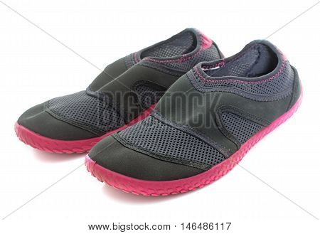 beach shoes in front of white background