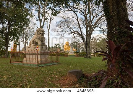 Chinese Classical Buddah And Stone Lions In A Temple