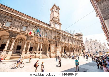 Milan, Italy - June 06, 2016: The Giureconsulti palace with clock tower on Mercanti square near Duomo square in Milan city center