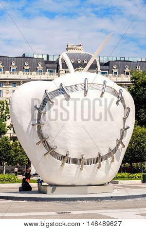 Milan, Italy - June 07, 2016: The monumental sculpture The Reintegrated Apple in front of Milan's central railway station by Michelangelo Pistoletto