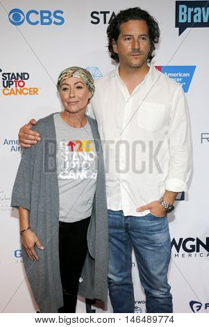 Kurt Iswarienko and Shannen Doherty at the 5th Biennial Stand Up To Cancer held at the Walt Disney Concert Hall in Los Angeles, USA on September 9, 2016.
