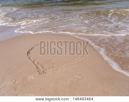 Hand-drawn heart on the sand beach with the coming wave