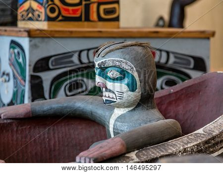 Sculpture of Totem in Carved Inuit Canoe