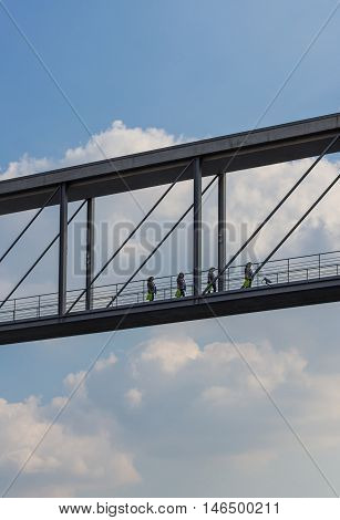 Woman Walking Over Modern Bridge - Cloud Sky Background