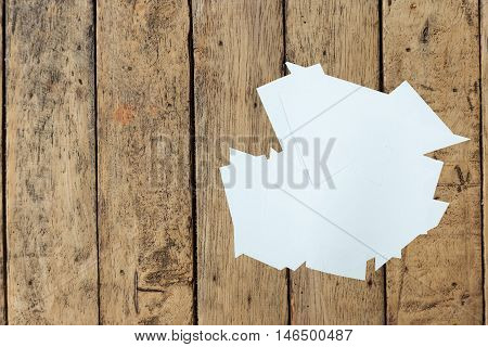 Clear paper cutting on a wood table