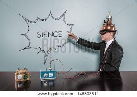 Sience concept with vintage businessman pointing hand