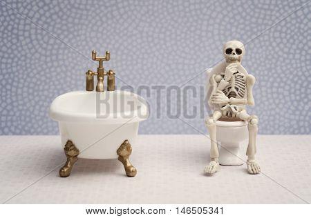 Skeleton sitting on water closet while thinking