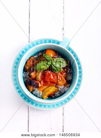 Vegetable ragout with rice in a bowl top view
