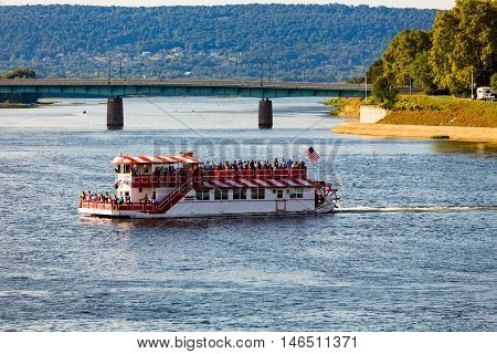 Harrisburg PA - September 3 2016: The Pride of the Susquehanna riverboat cruises near the Interstate 81 bridge.