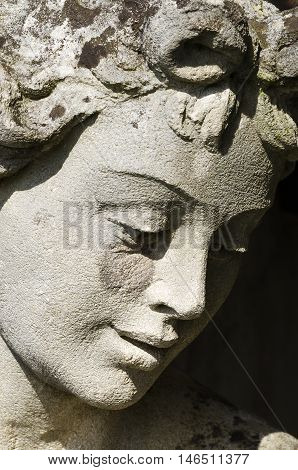 Ancient statue and face of Demeter, goddess of harvest, agriculture, nature and seasons in greek religion and mythology. Sculpture of one of the Twelve Olympians, major deities of Greek pantheon.