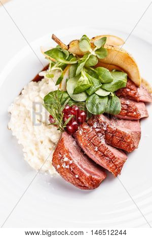 Roast goose breast on white plate fine dining
