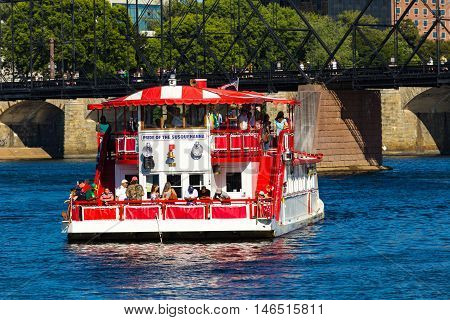 Harrisburg PA - September 3 2016: The Pride of the Susquehanna riverboat cruises near one of the city's bridges.