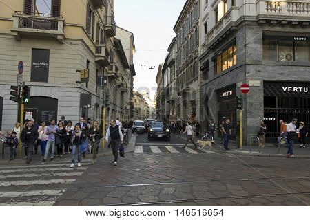 MILAN, ITALY - APRIL 13 2015: Via Montenapoleone street in Milan with people around at day time
