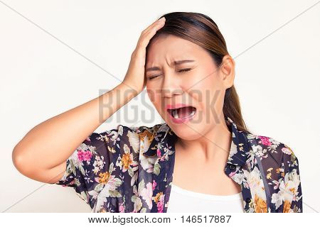 Asian woman having headache on white background
