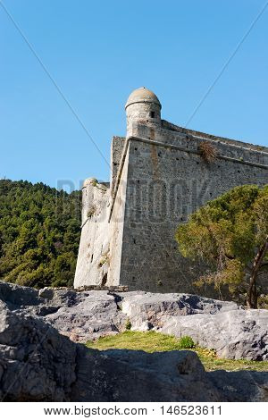 The Doria Castle (1164-XIX century) with a sentry box on a clear blue sky in Portovenere town (UNESCO world heritage site) Liguria Italy