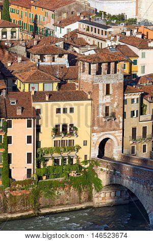 The tower of the Ponte Pietra (Stone bridge) - 1st century B.C. - the oldest Roman monument in Verona (UNESCO world heritage site) and the Adige river Veneto Italy