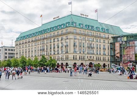 Berlin Germany - August 14 2016: View of Pariser Platz a square in the centre of Berlin with Hotel Adlon Kempinski people enjoying a summer day and soap bubbles as attraction for tourists