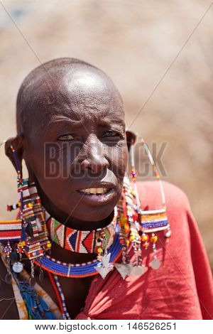 Amboseli Kenya - February 07 2012 - Portrait of masai man in typical clothing in masai village in Amboseli national park