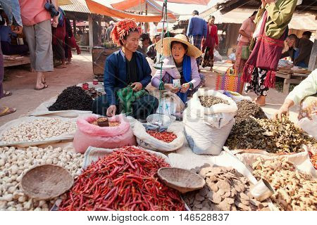 Heho Myanmar - March 03 2011 - Burmese women selling food at five-day market on the ground