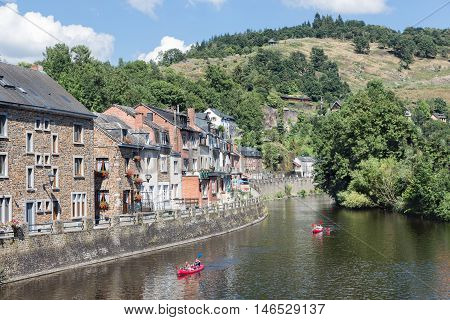 LA ROCHE-EN-ARDENNES BELGIUM - AUG 13: People with Kayaks on August 14 2016 at river Ourthe in the historic centre of La Roche-en-Ardenne Belgium