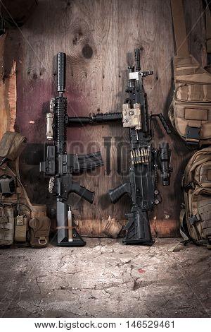 assault rifle and heavy machine gun on a wooden background