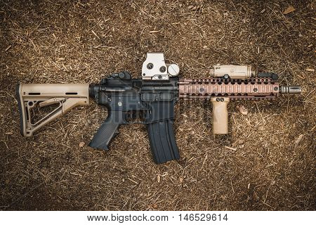 assault rifle on the forest ground - special forces weapon