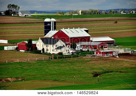 Lancaster County Pennsylvania - October 14 2015: A large Amish farm complex with farmhouse, barns, silos, and surrounding farmlands