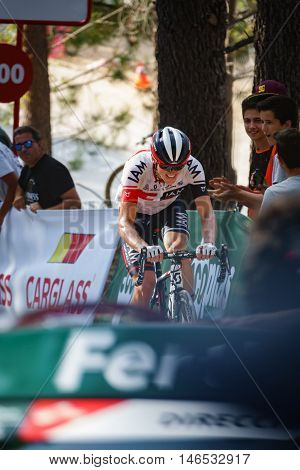 CASTELLON - SEPTEMBER 7: Mathias Frank approaches to finish line in Mas de la Costa mountain stage of la vuelta on September 7, 2016 in Castellon, Spain