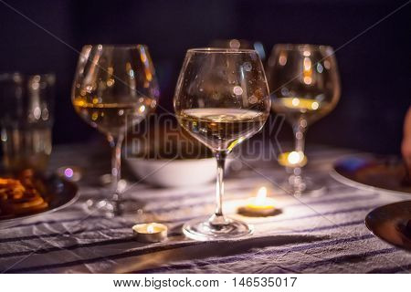 evening candle light dinner with wine in glasses in restaurant