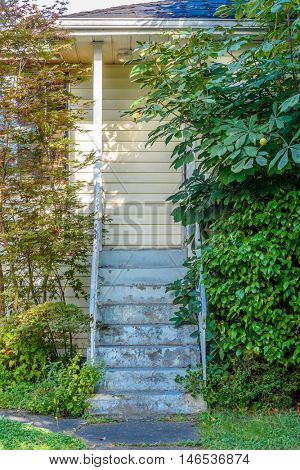 Stairs of entrance of an Old House in Disrepair.