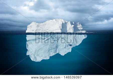 An Mostly Underwater Iceberg Floating in Ocean