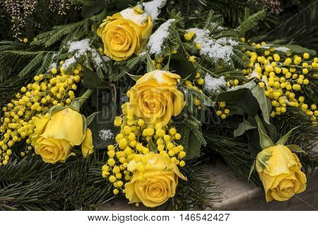 A Bunch of flowers with yellow roses