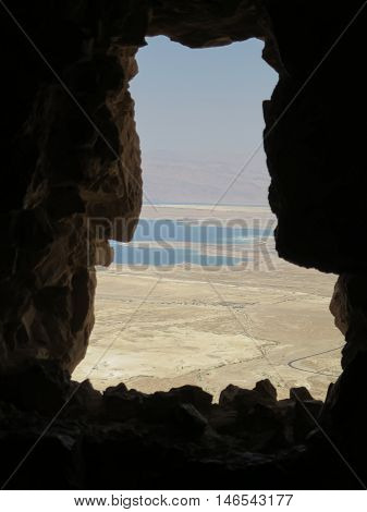 A view of the Dead Sea through a window in the ruins of the Masada Fortress.