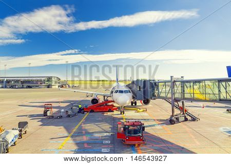 Airplane at the terminal gate ready for takeoff - Waiting for the flight.Travel around the world