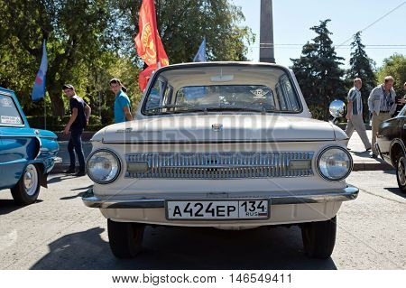 Beige Zaporozhets At The Exhibition Of Vintage Cars Made In The Ussr On The Forecourt Under The Open
