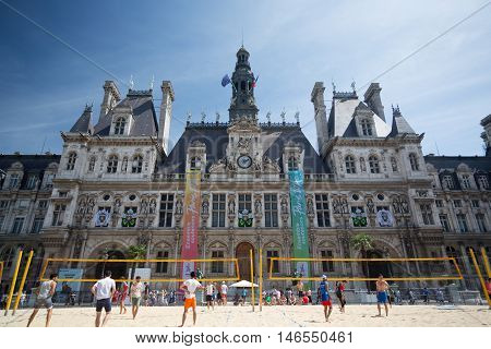 PARIS FRANCE - AUGUST 13 2016. People playing beach volley in front of the Hôtel de Ville in the centre of Paris
