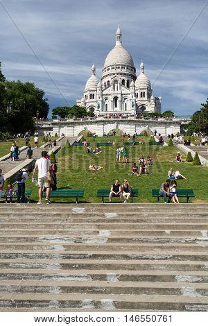 PARIS FRANCE - AUGUST 14 2016. Sacre Coeur Basilica in summer day. Large medieval cathedral. Basilica of Sacred Heart. Popular landmark highest city point.
