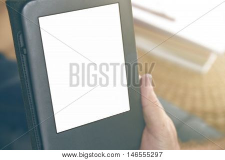 A man holding an ebook reading some documents. Empty copy space for Editor's text.