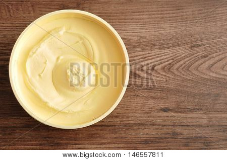 Yellow Butter isolated on a wooden background